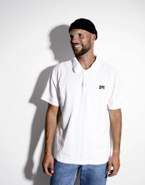 Men's polo shirt in white color with CAT logo